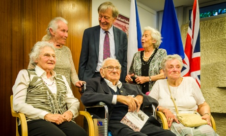 Sir Nicholas Winton with some of the people, then children, whom he saved from the Nazis in 1939. Photograph: Dana Psenicova