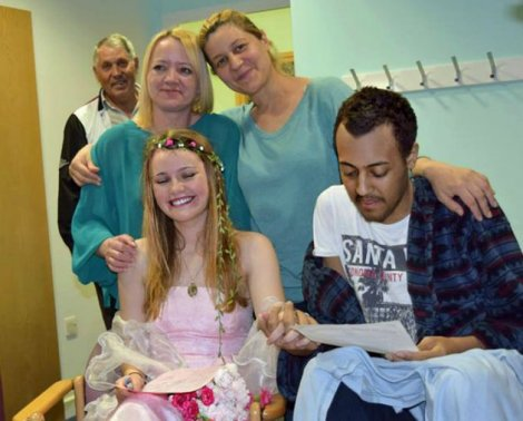 PIC FROM CATERS NEWS - (PICTURED: Omar, Amie with Omars mother, Mira and Amies mother, Becky Cook) - This is the heartbreaking moment two teenage sweethearts tied the knot  only three days before the husband died from leukaemia. Just days after Omar Al Shaikh slipped a makeshift wedding ring made of flowers on to blushing bride Amie Cresswells finger, he tragically passed away. Having found out he only had days left to live, the 16-year-old was determined to wed Amie, also 16, in a hospital ceremony. SEE CATERS COPY.