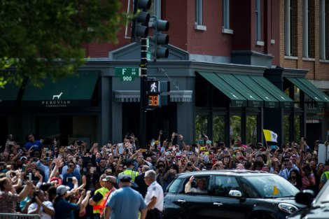 A cheering crowd welcomed Pope Francis as he headed to St. Patrick's Church in Washington on Thursday. Credit Gabriella Demczuk for The New York Times