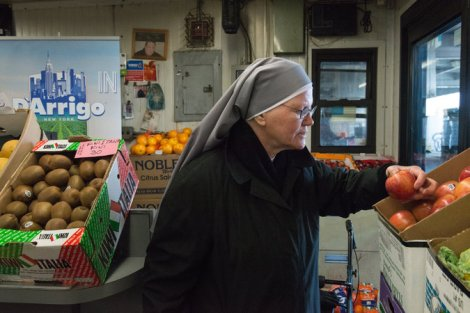 Sister Elisabeth Anne, of the Little Sisters of the Poor, visits the Hunts Point Terminal Market in the Bronx each week seeking donations of food for the Queen of Peace Residence in Queens. Credit Stephanie Keith for The New York Times