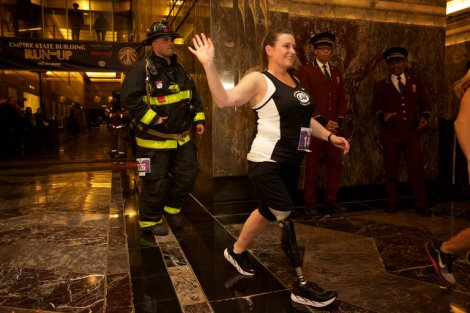 Roseann Sdoia, a survivor of the Boston Marathon bombing, and her boyfriend, Michael Materia, at the start of the Empire State Building Run-Up in New York on Wednesday night. The couple ran the event together; Mr. Materia ran in his firefighting gear. Credit Benjamin Norman for The New York Times